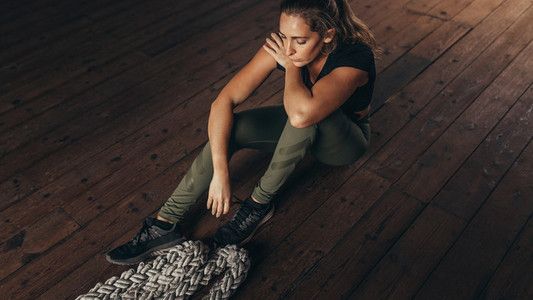 Woman taking rest after working out at fitness studio