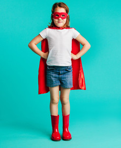 Cute girl in red superhero costume