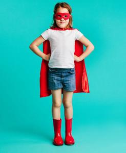 Cute girl in red superhero costume