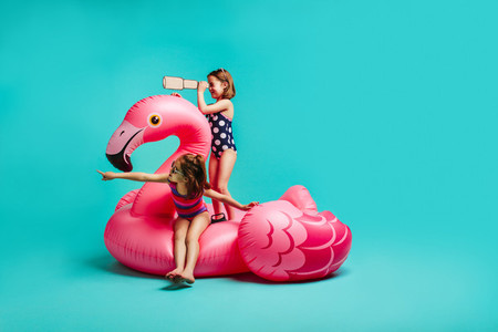 Two girls playing on inflatable toy