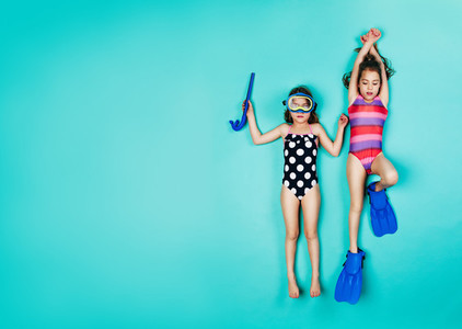 Twin girls pretending to be snorkelling