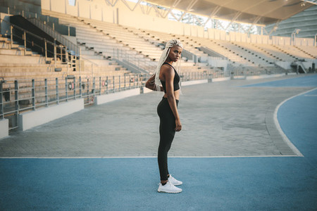 Athlete standing near the stands in a stadium