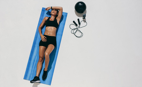 Fitness woman doing workout lying on floor