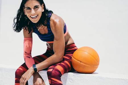 Smiling fitness woman relaxing after workout