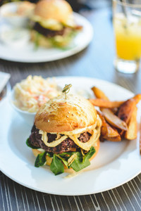 Juicy beef burger with potatoes