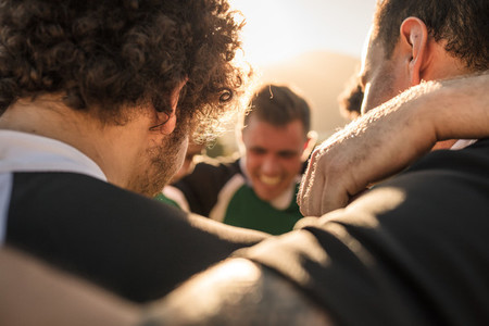 Team of rugby players in a huddle