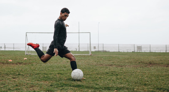 Soccer player practicing on field