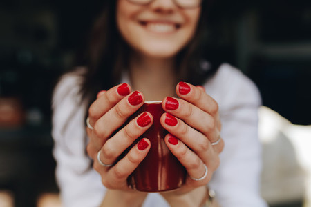 Woman hands holding a coffee cup