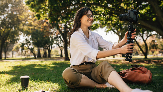Female vlogger vlogging from a park