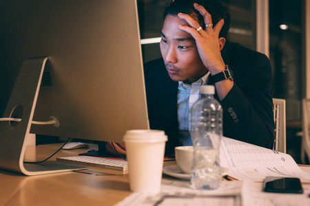 Businessman stressed out during work