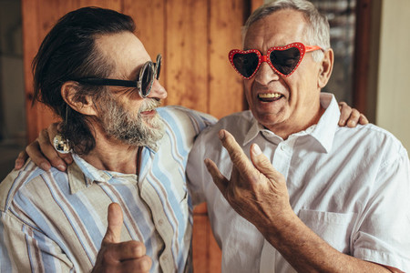 Elderly friends with crazy eyewear having fun