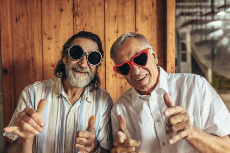 Senior men wearing funny sunglasses