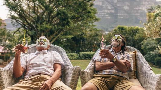 Retired friends enjoying facial spa treatment