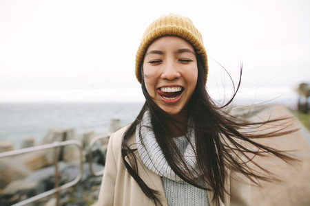 Smiling woman standing outdoors having fun