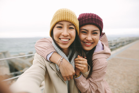 Close up of two asian women standing together outdoors