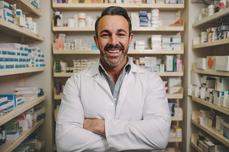 Confident mature male pharmacist
