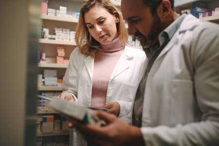 Pharmacists searching for a medication in the store