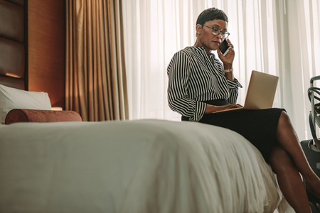 Businesswoman on tour working from hotel room