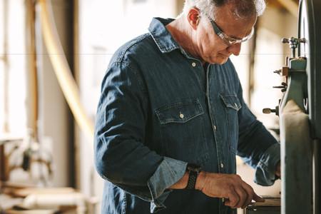 Carpentry worker working in his workshop