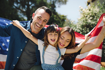 Close up of a happy family holding the american flag