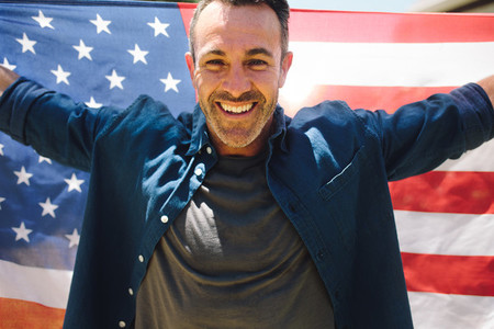 Portrait of a man holding american flag