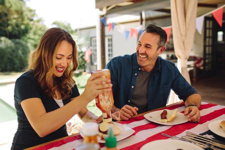 Smiling couple having fun dining