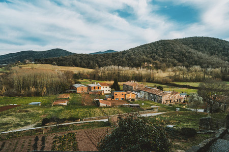 A view of some houses and farm fields from above