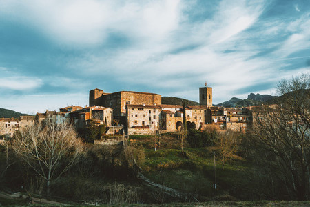 A cityscape of the medieval village of Santa Pau