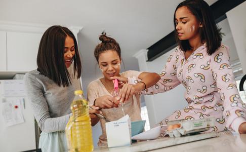 Girls preparing breakfast in kitchen