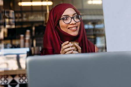 Pretty islamic girl in hijab at coffee shop