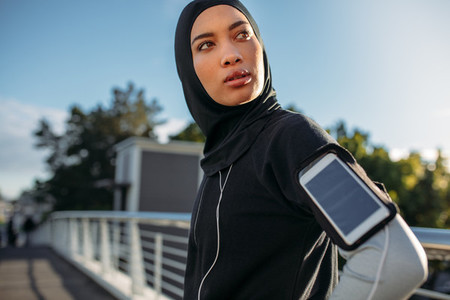 Hijab girl taking a break after workout in city