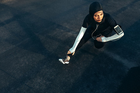 Muslim woman doing exercise in morning
