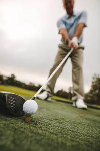 Senior golfer taking a shot at golf course