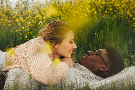 Romantic couple lying in meadow