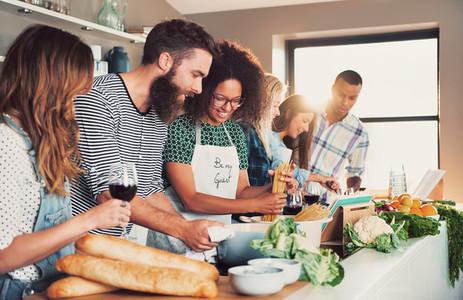 Multiracial friends cook tasteful food