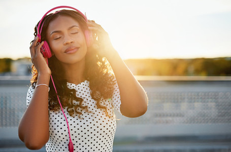 Woman enjoying the flow of music