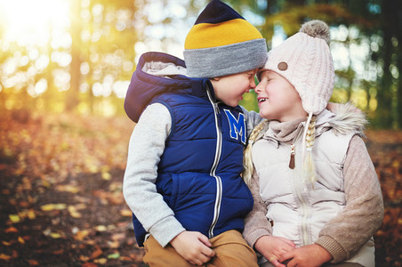 Two children touching each other with noses