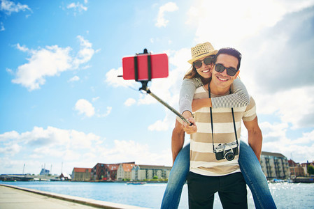 Fun loving young tourists taking a selfie