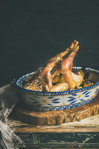 Roasted whole chicken for Christmas  black wall background  copy space