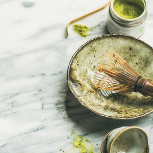 Japanese tools for brewing matcha tea marble background square crop