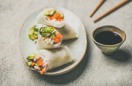 Shrimp and vegetable rice paper spring rolls  grey background