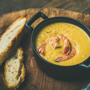 Winter Corn creamy soup with shrimps in pot  square crop