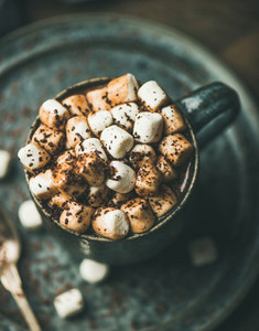 Winter warming hot chocolate with marshmallows in mug