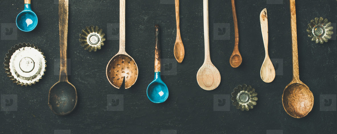 Various vintage kitchen spoons and baking tin molds  top view