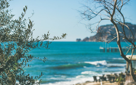 View over the blue sea beach and castle hill of Alanya