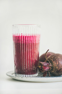 Fresh morning detox beetroot smoothie in glass  white background