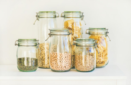 Various raw cereals grains beans and pasta for healthy cooking