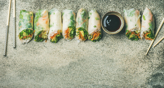 Flat lay of vegan spring or summer rice paper rolls