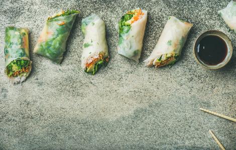 Flat lay of vegan spring or summer rice paper rolls