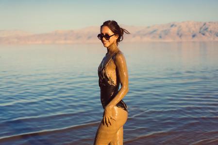 A young woman enjoying the natural mineral mud